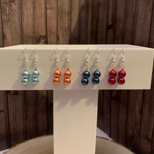 Four pairs of double layered pearl earrings